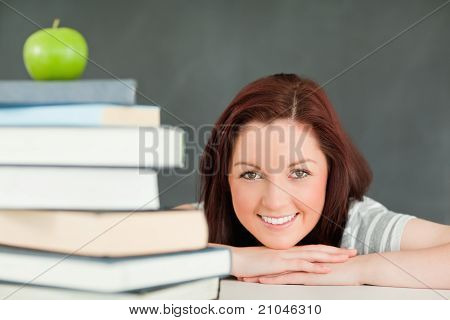 Young Student With An Apple And Books In The Foreground
