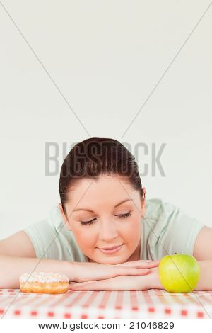Charming Woman Posing With A Donut And A Green Apple