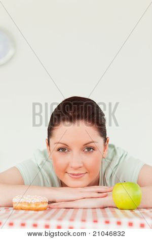 Pretty Woman Posing With A Donut And A Green Apple