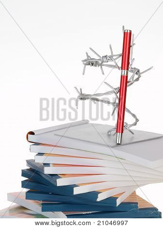 The Barbed Wire And A Pen On Note Book Stack
