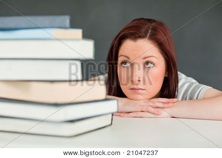 Desperate Student Looking At Her Books