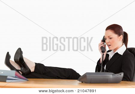 Unhappy Business Woman On The Phone In Her Office