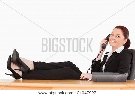 Good Looking Businesswoman On The Phone In Her Office