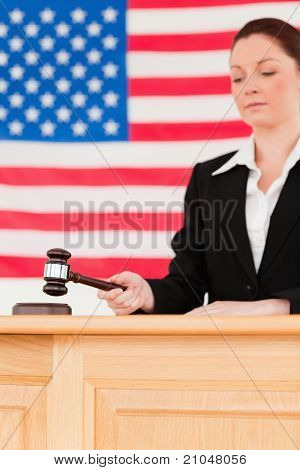 Portrait Of A Focused Judge Knocking A Gavel