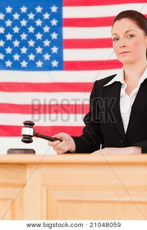 Portrait Of A Serious Judge Knocking A Gavel