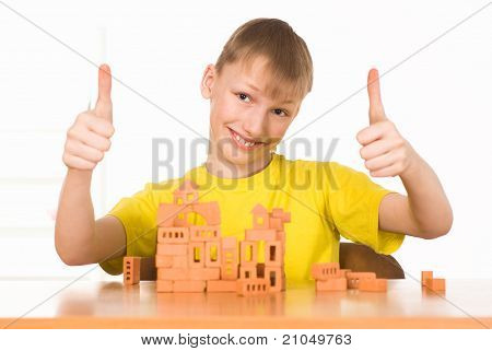 Young Boy Constructing
