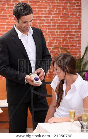 Husband giving wife a present