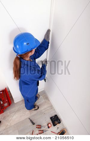 Female technician with safety clothing