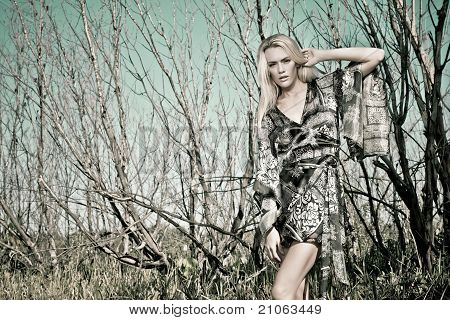 Blond Woman In Forest