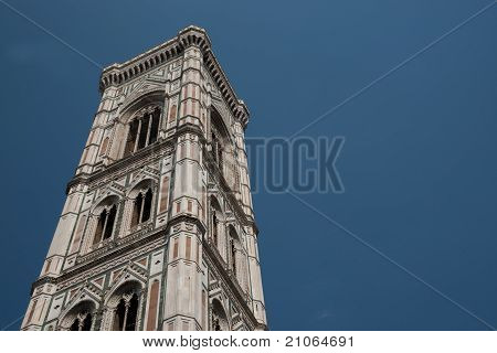 Church tower isolated against blue sky.
