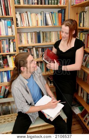 Students Talking In A Library