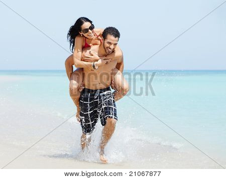 Piggyback Ride With Happy Man And Woman