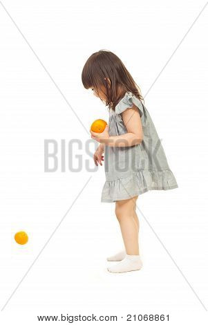 Little Girl Playing With Mandarins