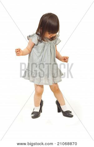 Little Girl Wearing Big Shoes