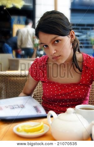 Teenage Girl In Street Cafe