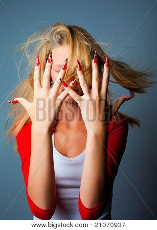 Girl with fashionable design of nails