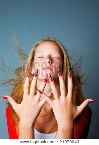 Girl with closed eyes and fashionable design of nails