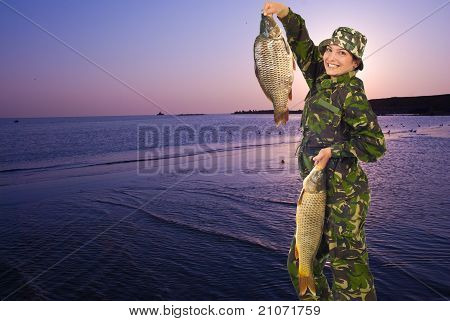 Happy Fisherwoman Holding Big Carps