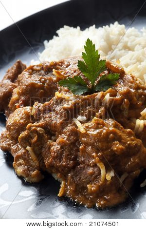 Rogan josh with rice.  Delicious Indian curry.