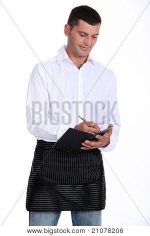 Male waiter taking order