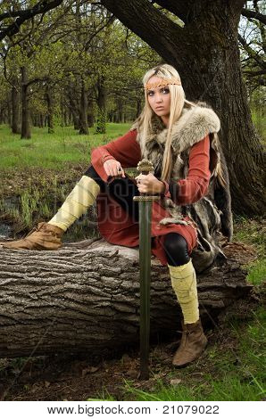 Viking Girl  With Sword In A Wood