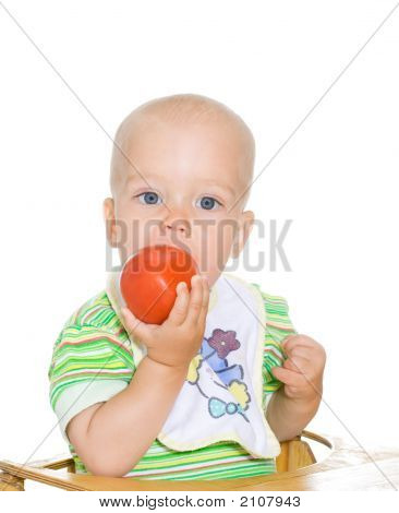 Child Eating Red Tomato