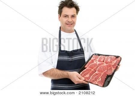 Butcher Showcasing Steak