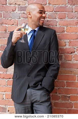 Laughing Young Businessman With A Glass Of Wine
