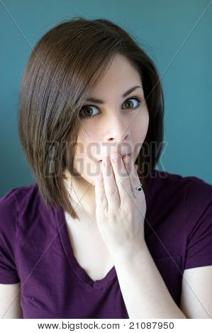Young Woman Covering Mouth