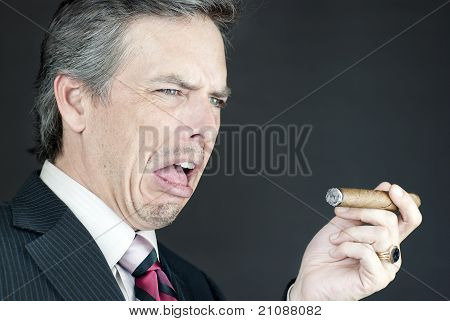 Businessman Looks At Cigar In Disgust
