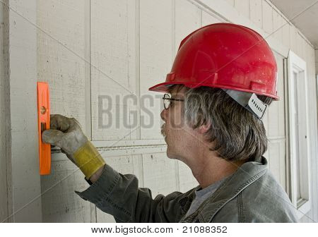 Carpenter Checking Level