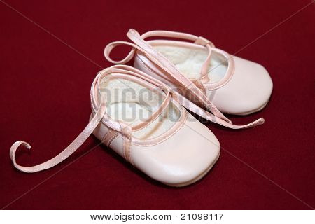 Pink Baby Shoes On Red