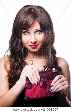 Charming brunette with theatrical red handbag on white