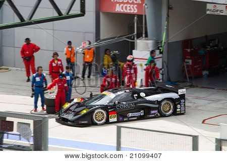 Team Thunderasia exits pit at the Malaysian SuperGT race