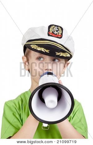Little boy in the green t-shirt and in the sea peaked cap says something into the megaphone