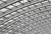 foto of purlin  - Section of the curved reinforced steel roof joists in a conservatory with glass panes in between - JPG