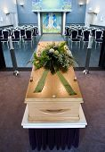 picture of mortuary  - A coffin with a flower arrangement at a mortuary - JPG