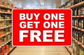 Buy One Get One Free Red Label On An Abstract Supermarket Background poster