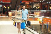 picture of shopping center  - Handsome couple at the shop center - JPG