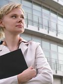 Business Woman Standing Outside A Modern Office Building poster