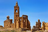 a view of the remains of the old town of Belchite, Spain, destroyed during the Spanish Civil War and poster