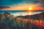 Sunset sky background. Natural Sunset Sunrise Over Ocean. Bright Dramatic Sky And Blue Water. Colorf poster