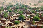 stock photo of dogon  - A horizontal close up of a Dogon village from below the Bandiagara cliff in Mali - JPG
