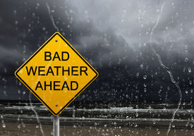 picture of warning-signs  - yellow warning sign of bad weather ahead against stormy sky - JPG