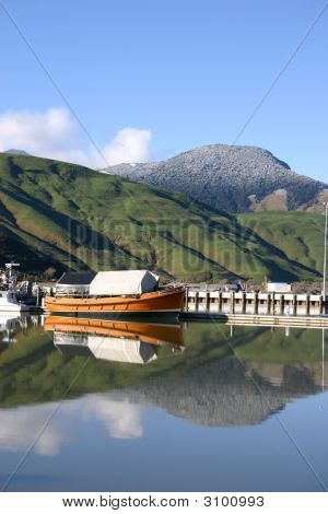 Orange Boat New Zealand Reflection