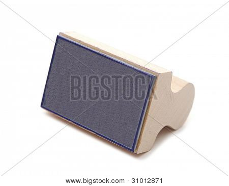 Wooden rubber stamp isolated on white background