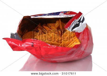 tasty potato chips in bag isolated on white