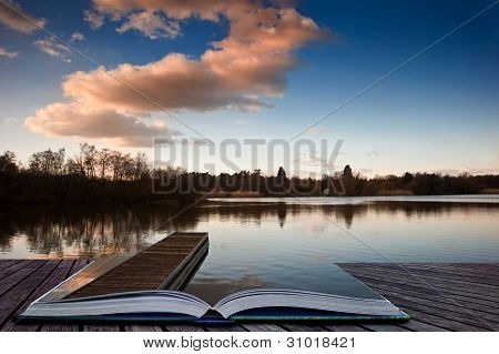 Sunset Landscape Over Jetty On Lake Coming Out Of Magic Book Pages