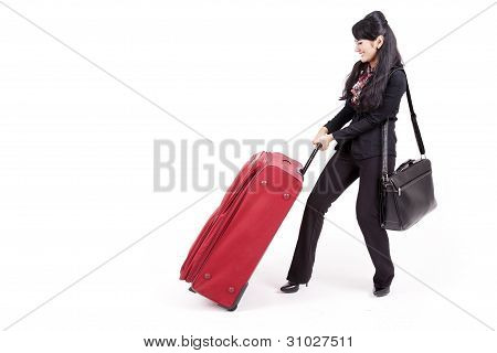 Businesswoman Pulling Heavy Suitcase