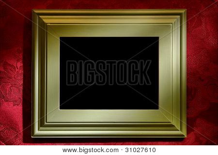 Green Picture Frame Over Red Wallpaper Background